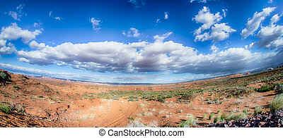 panorama of a valley in utah desert with blue sky
