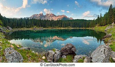 Panorama of Alps lake landscape with forrest mountain, Lago di Carezza - Dolomites