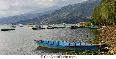 Panorama of an old wooden boat at the Phewa Lake in Pokhara