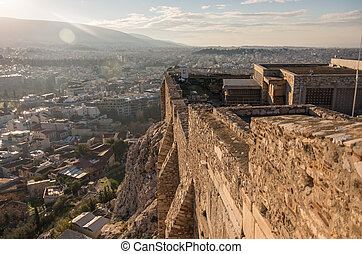 Panorama of Athens city from Acropolis hill with fortress walls at foreground, Athens, Greece