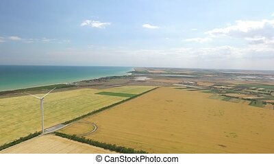 Panorama of beautiful landscape with wind generators in the coastal strip. Aerial survey
