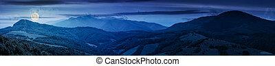 panorama of beautiful mountain ridge at night in full moon...
