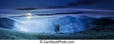 mountainous countryside at night - panorama of beautiful...