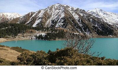 Panorama of beautifull mountain lake landscape in Almaty