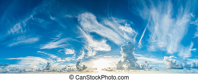 panorama of blue cloudy sky and rising sun