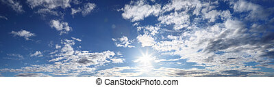 panorama of blue sky with sun and c