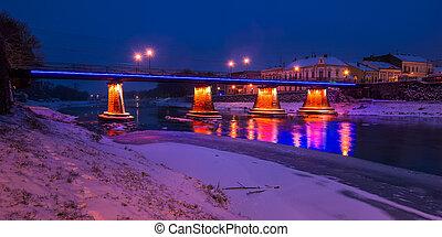 panorama of bridge through the river Uzh at night. beautiful...