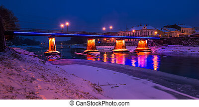 panorama of bridge through the river Uzh at night. beautiful...