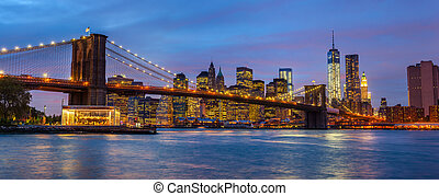 Panorama of Brooklyn Bridge with lights and reflections