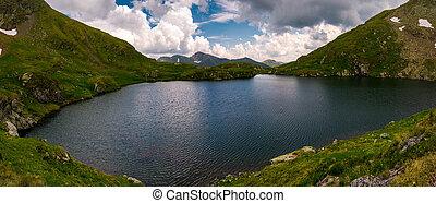 panorama of Capra lake, Romania. gorgeous landscape of...