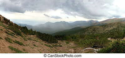 Panorama of Colorado Springs, CO, USA from Pikes Peak mountain cloudy day