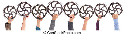 Panorama of different hands holding gears meshing