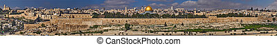 Panorama of East Jerusalem, view of the Old City and holy places of Judaism, Christianity and Islam: Temple Mount, Kotel, Church of the Holy Sepulcher, Al-Aqsa Mosque and Dome of the Rock, Gethsemane Garden and the Chapel of Ascension, Israel.