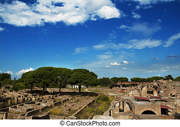 Panorama of excavation of Ostia Antica near Rome with blue sky and clowds