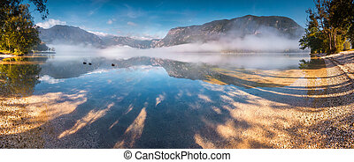 Panorama of foggy summer morning on the Bohinj lake in ...