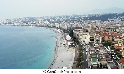 Panorama of French luxury city of Nice, people swimming in sea