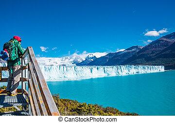 Panorama of glacier Perito Moreno in Patagonia and lonely hiker