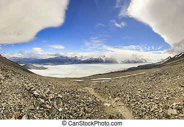 panorama of Grey glacier in patagonia at sunset with lenticular clouds on sky