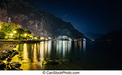 Panorama of illuminated town Limone sul Garda, Italy. Travel...