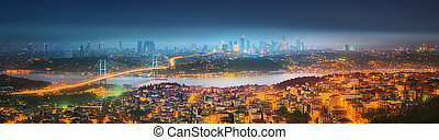 Panorama of Istanbul and Bosphorus bridge at night,...