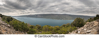 Panorama of lake Vrana on a cloudy, stormy day in spring