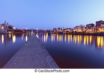 Panorama of Liege along Meuse River seen at evening. Liege, ...