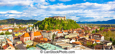 Panorama of the vibrant Slovenian capital Ljubljana in afternoon sun.
