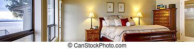 Panorama of master bedroom wtih water view.