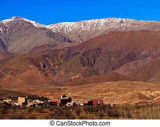 Atlas Mountains, Panoramic view of Moroccan village and snowcapped Atlas mountains, Morocco