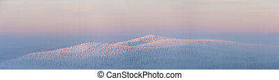 Panorama of mountain in winter at sunset