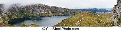 Panorama of mountain peak with lake