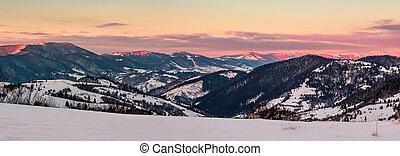 panorama of mountain ridge at dusk in winter - panorama of...