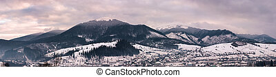 panorama of mountain ridge at sunrise. gorgeous winter...