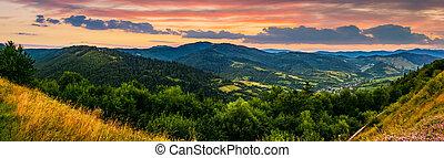 panorama of mountain ridge with peak at sunset - panorama of...