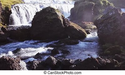 Panorama of mountain river with rapids and waterfalls, Iceland