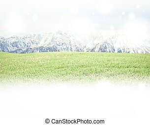 Panorama of Mountain Snow Landscape with green grass .