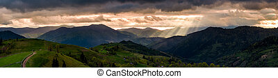 panorama of mountainous countryside at sunset. country road...