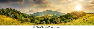 panorama of mountainous countryside at sunset - panorama of...