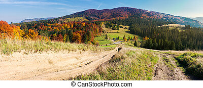 panorama of mountainous landscape in autumn. country road...