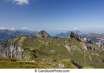 Panorama of mountains in switzerland on a sunny day in summer