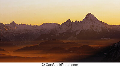 alps - panorama of mountains in the alps at sunset