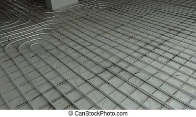 Panorama of network of pipelines of floor heating system in ...