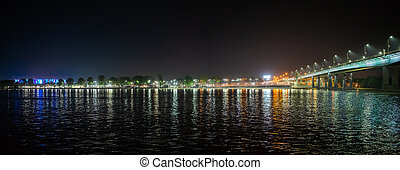 Panorama of night city embankment on left bank of river Don of Rostov-on-Don