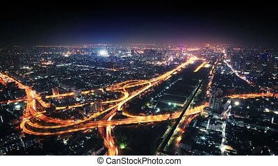 Panorama of night city with road junction.