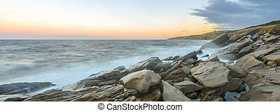 Panorama of ocean shore at a crack of dawn (Slow shutter ...