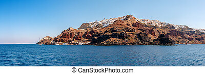 Panorama of Oia town from the sea on Santorini