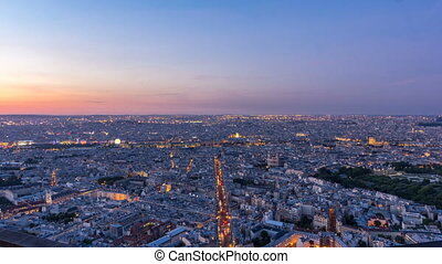 Panorama of Paris after sunset day to night timelapse. Top view from montparnasse building in Paris - France