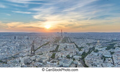 Panorama of Paris at sunset timelapse. Eiffel tower view from montparnasse building in Paris - France