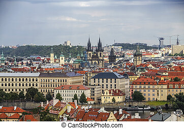 Panorama of Prague Old Town with red roofs , famous Charles bridge and Vltava river, Czech Republic. View from above
