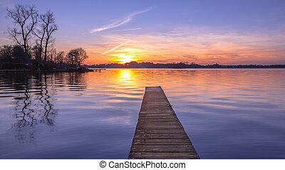 Panorama of purple Sunset over Serene Lake